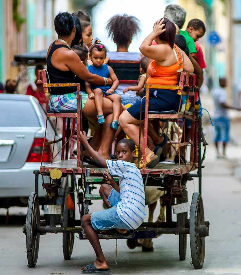 Cubans in horse-drawn cart.